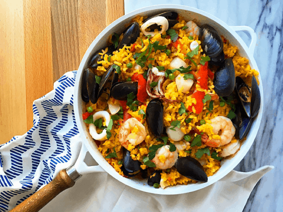 10 minutes of prep, lots of flavor and a complete healthy meal in one skillet! This simple Seafood Paella Recipe is the perfect weeknight meal (and goes great a glass of white wine).