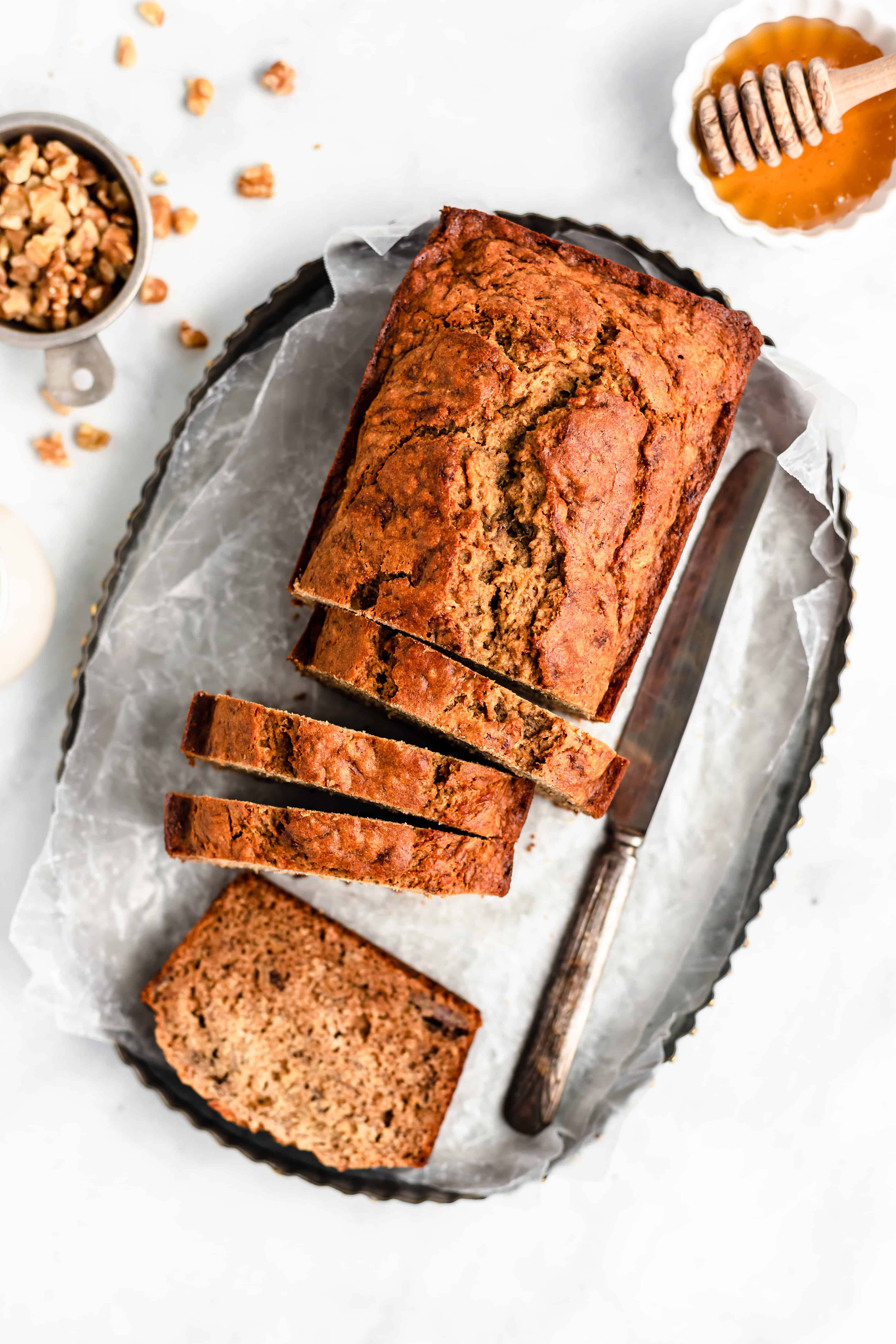 Moist and lightly sweetened Healthy Banana Bread – made with bananas, coconut oil, cinnamon, and whole wheat flour.