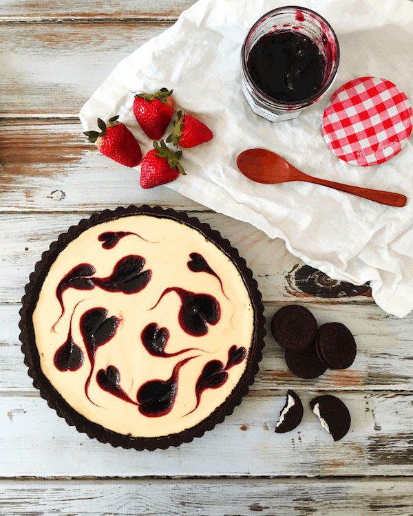 Easy, foolproof Berry Swirl Cheesecake Tart - made with a chocolate cookie crust and requires half the baking time of regular cheesecake.