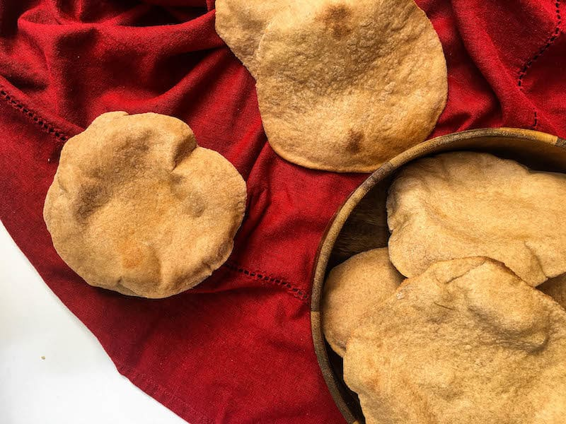 Easy and delicious homemade traditional Greek Pita Bread – you'll never want to go back to the store-bought version again!