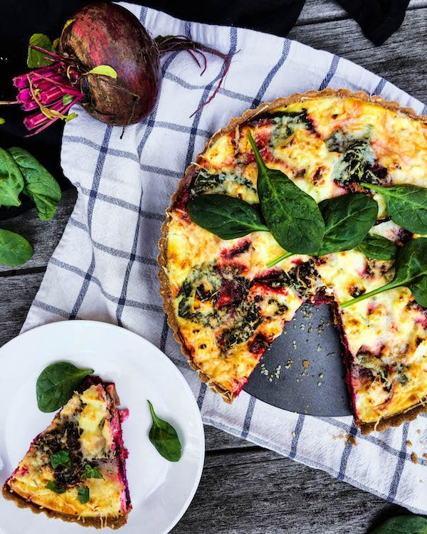 So delicious and easy to make, this Roasted Beet, Spinach, and Goat Cheese Quiche makes a great brunch or even dinner!