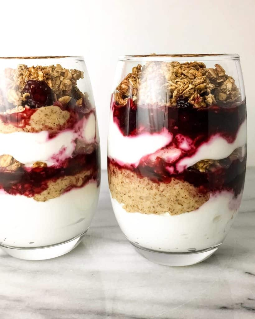 Greek Yogurt Parfaits layered with Granola, Blackberries, and Almond Butter. A healthy and flavorful breakfast or snack that can be prepared ahead and taken on-the-go.