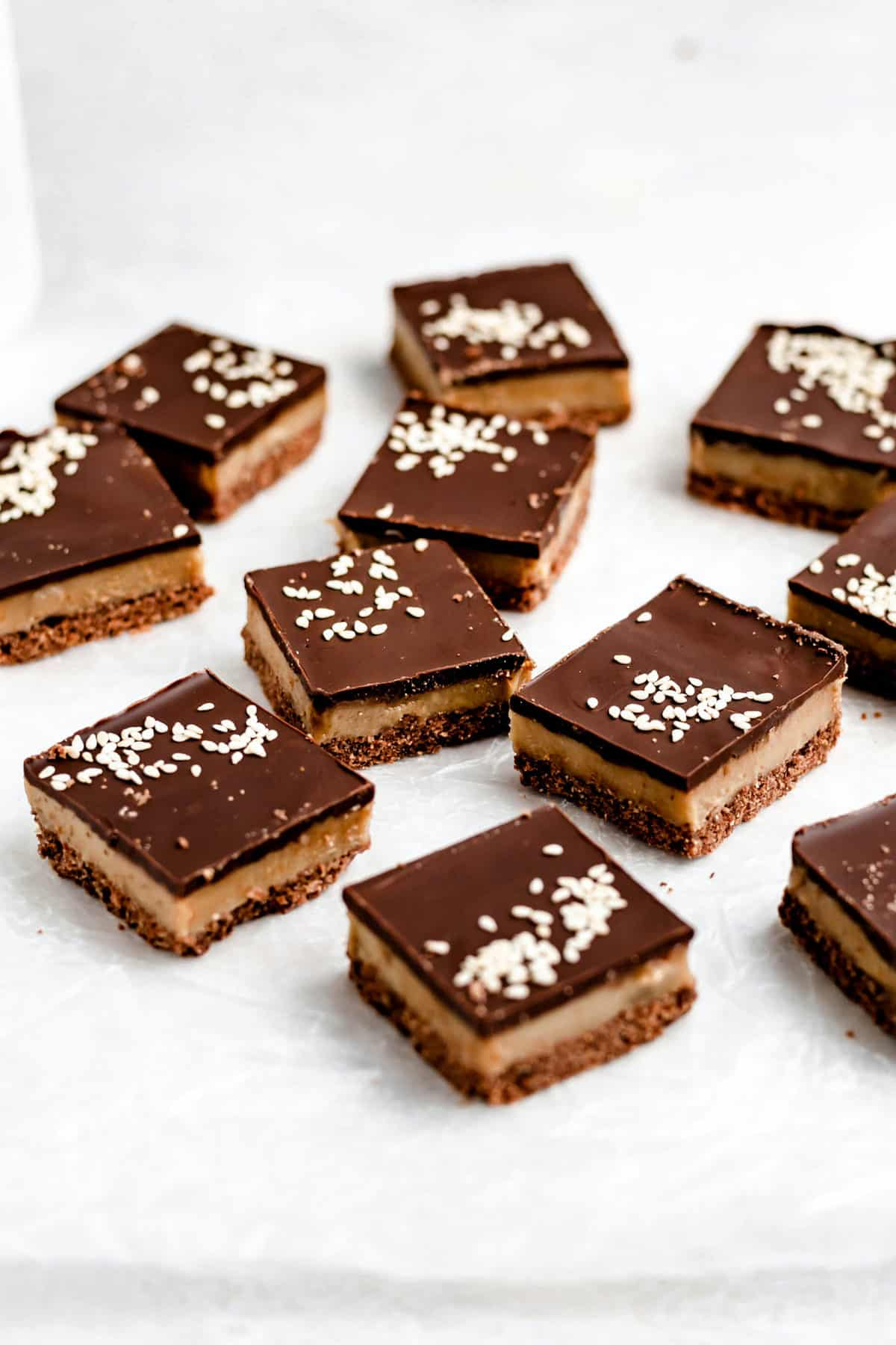 chocolate tahini bars on parchment paper