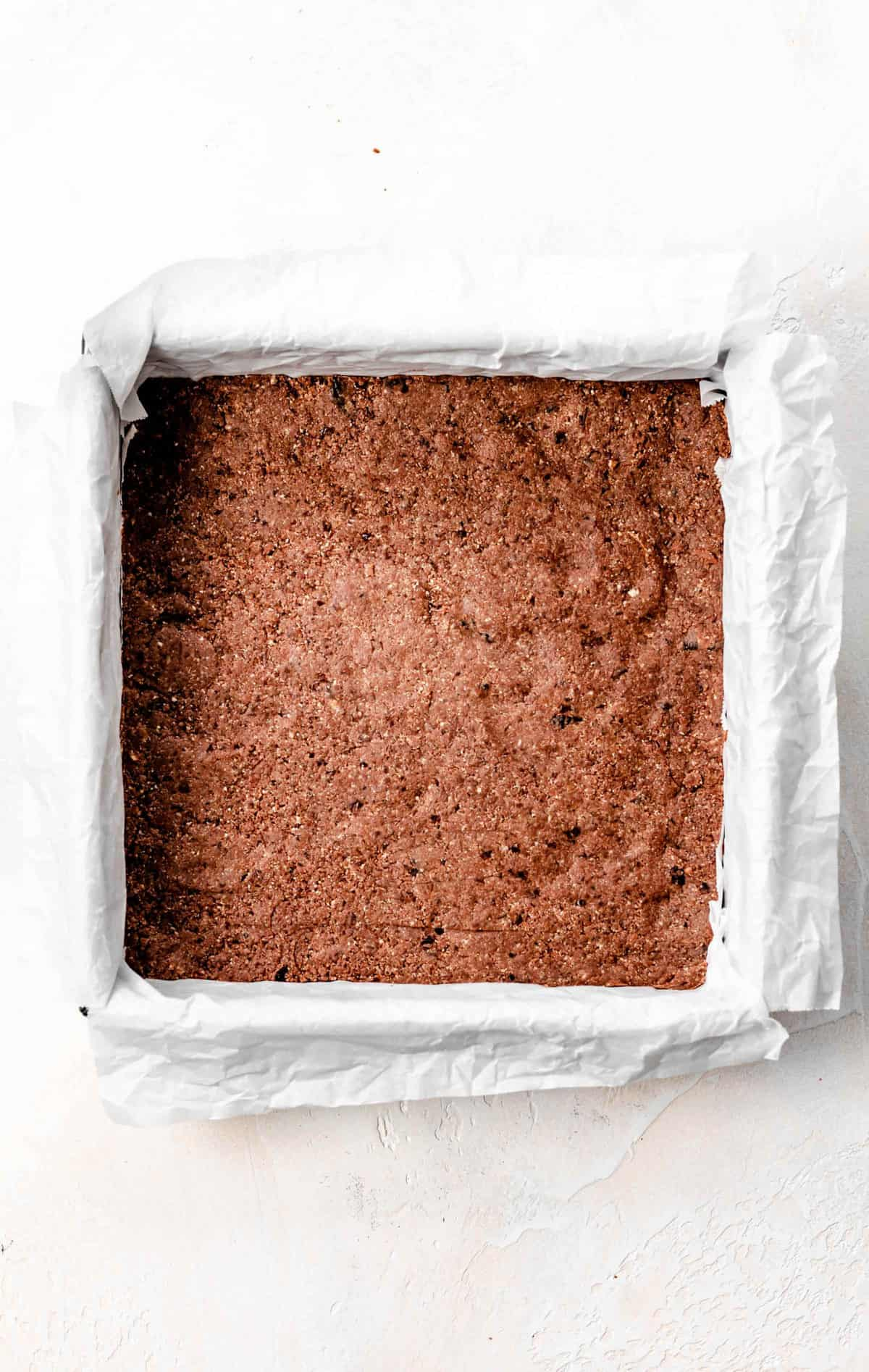 tahini bar crust in baking pan