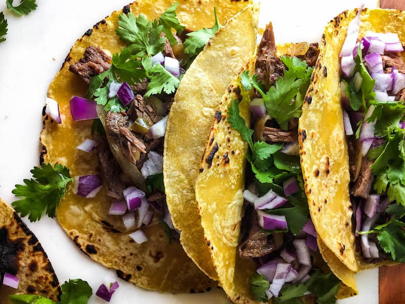 Delicious,tender, fall-apart meat stuffed in corn tortillas and topped with avocado, cilantro, and onion - theseEasy ShreddedBeef Tacos are so simpleand tasty!