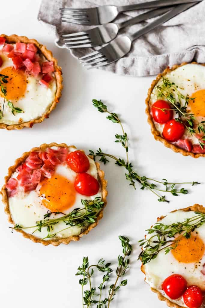 Easy Savory Breakfast Tarts made with a no-knead spelt crust and filled with goat cheese, eggs, and Canadian bacon. Perfect for breakfast or brunch, this combination is sure to satisfy appetites!