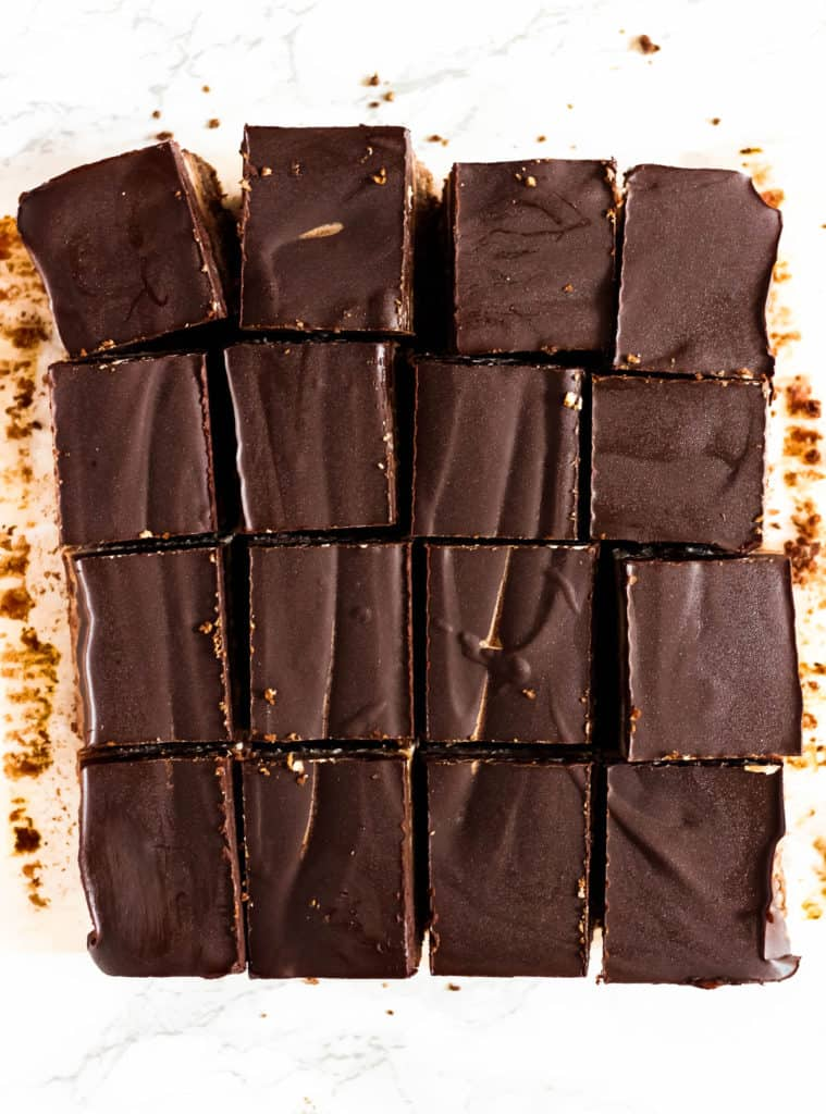 "These Chocolate Coconut Caramel Bars have three addicting layers – a chocolate coconut crust, the best coconut ""caramel"" filling, and a dark chocolate topping! (gluten-free, Paleo + vegan)"