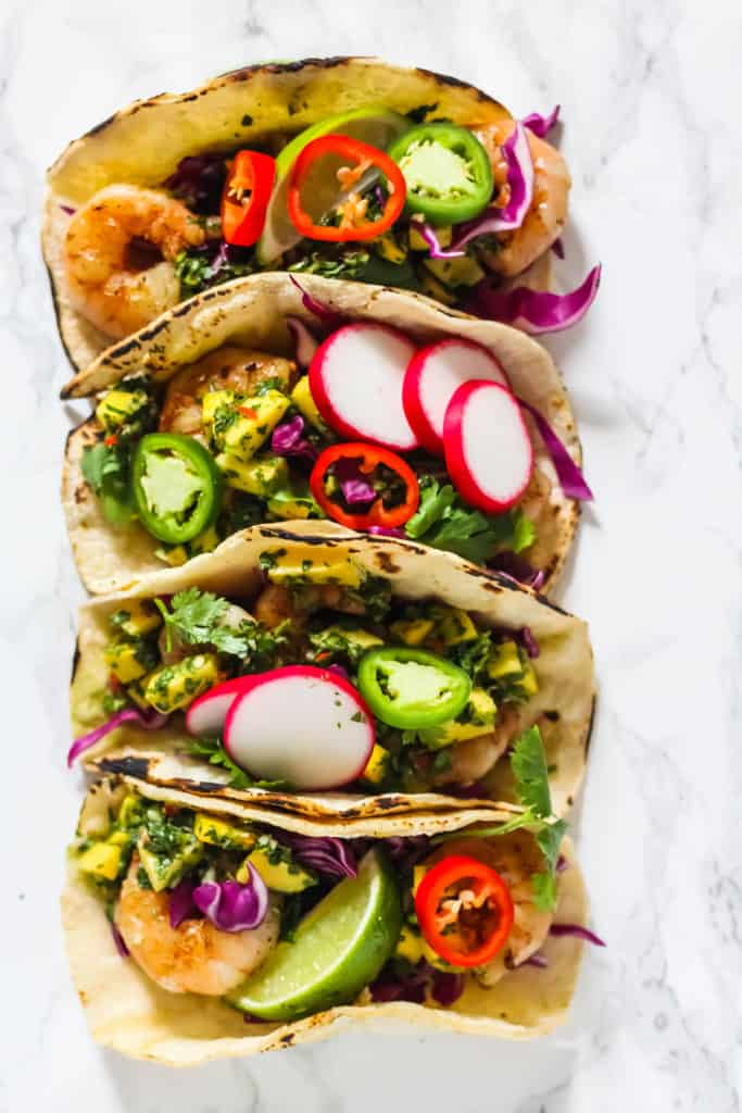 Easy and delicious Grilled Shrimp Tacos with Mango Chimichurri - full of delicious, healthy, & fresh ingredients. Made in 20 minutes!