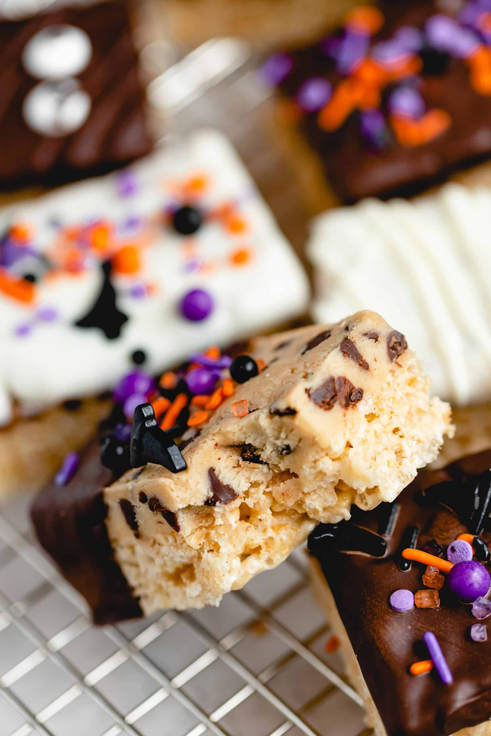 bite shot of a halloween themes cookie dough rice krispie treat