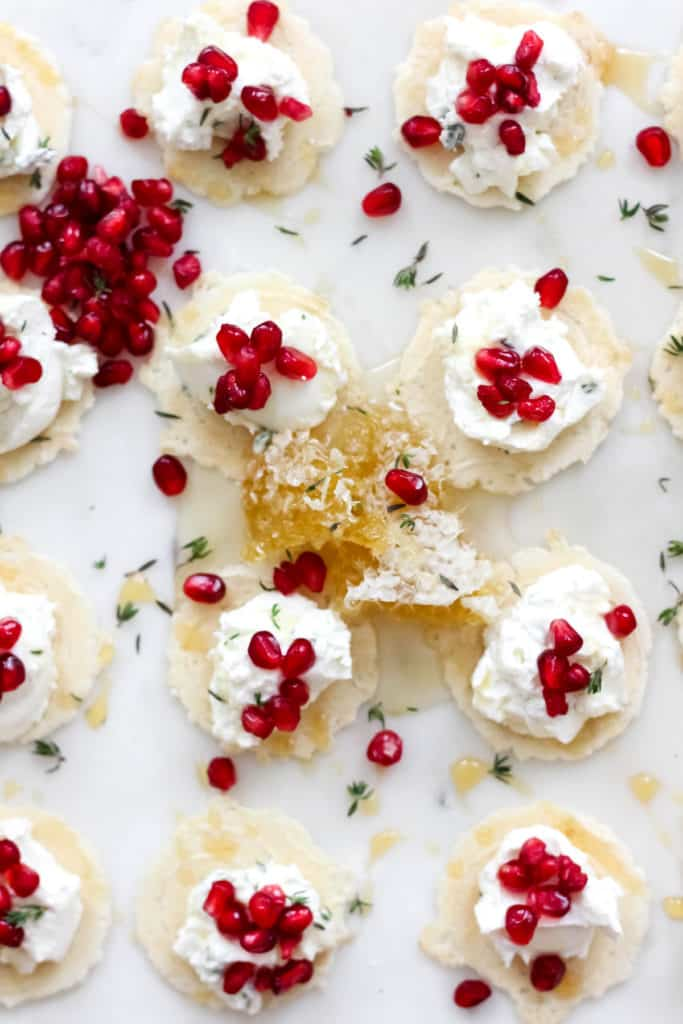 Simple, yet delicious Honey Thyme Whipped Goat Cheese Bites with Pomegranate are the perfect appetizer for the holidays!