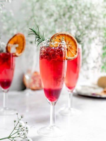 sparkling pomegranate cocktails in champagne flutes