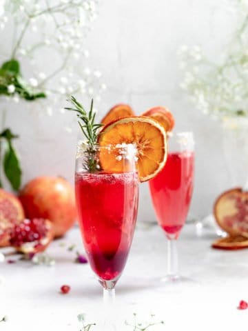 sparkling pomegranate cocktails in champagne flutes