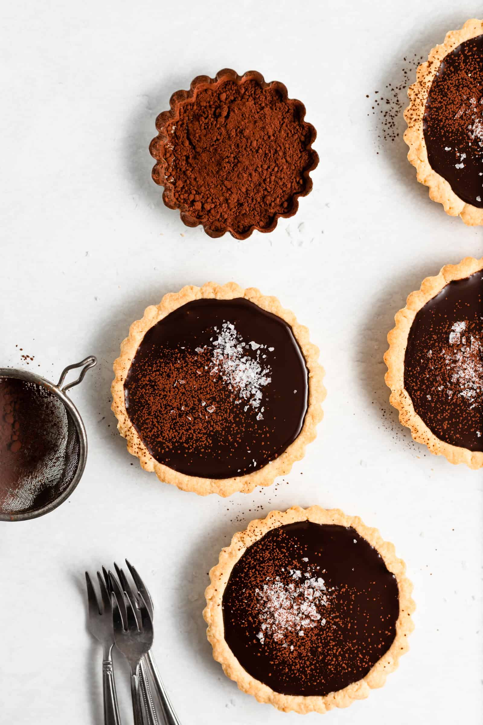 These Mini Dark Chocolate and Sea Salts Tarts have a buttery shortbread crust that's filled with a rich and decadent truffle-like filling and topped with sea salt!