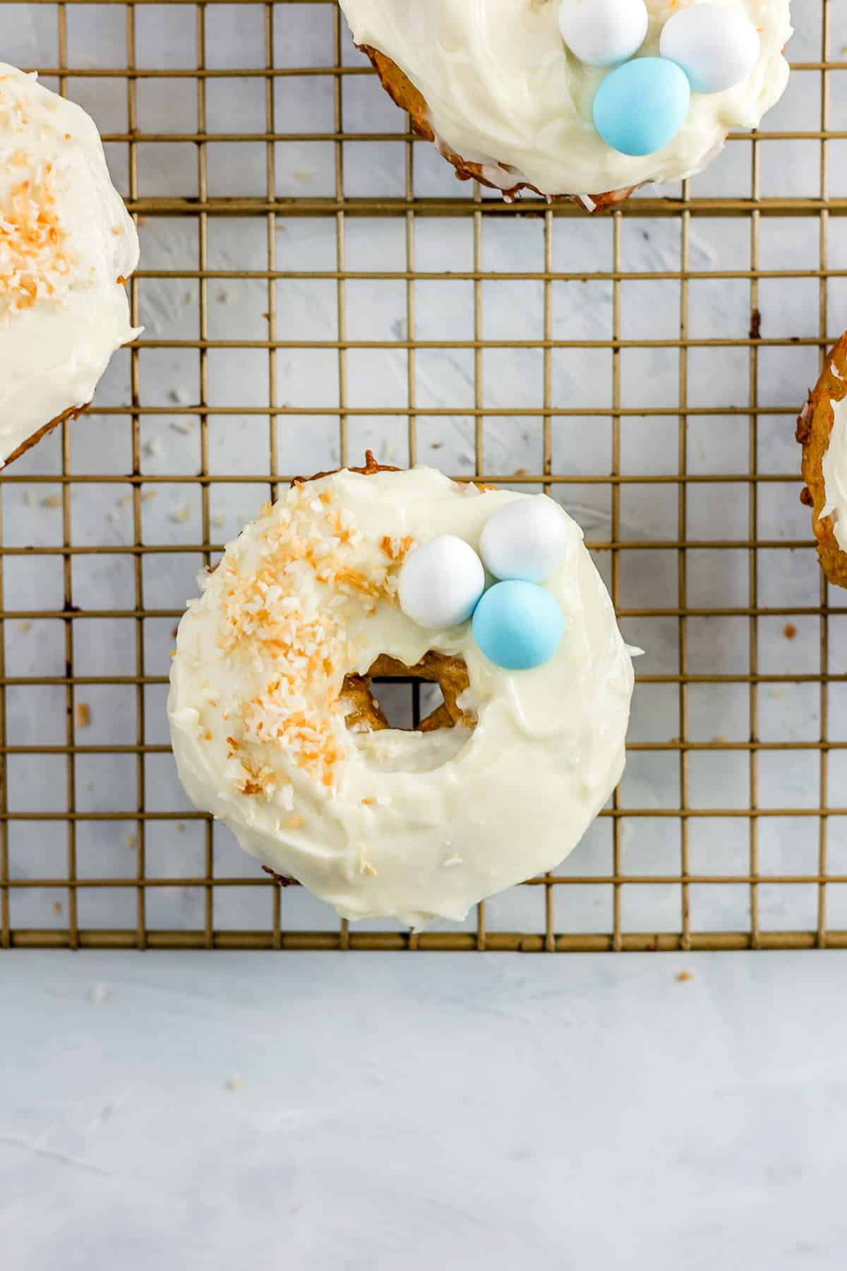 These irresistible Baked Carrot Cake Donuts with Cream Cheese Frosting are so easy to make and are perfect for an Easter or spring brunch!