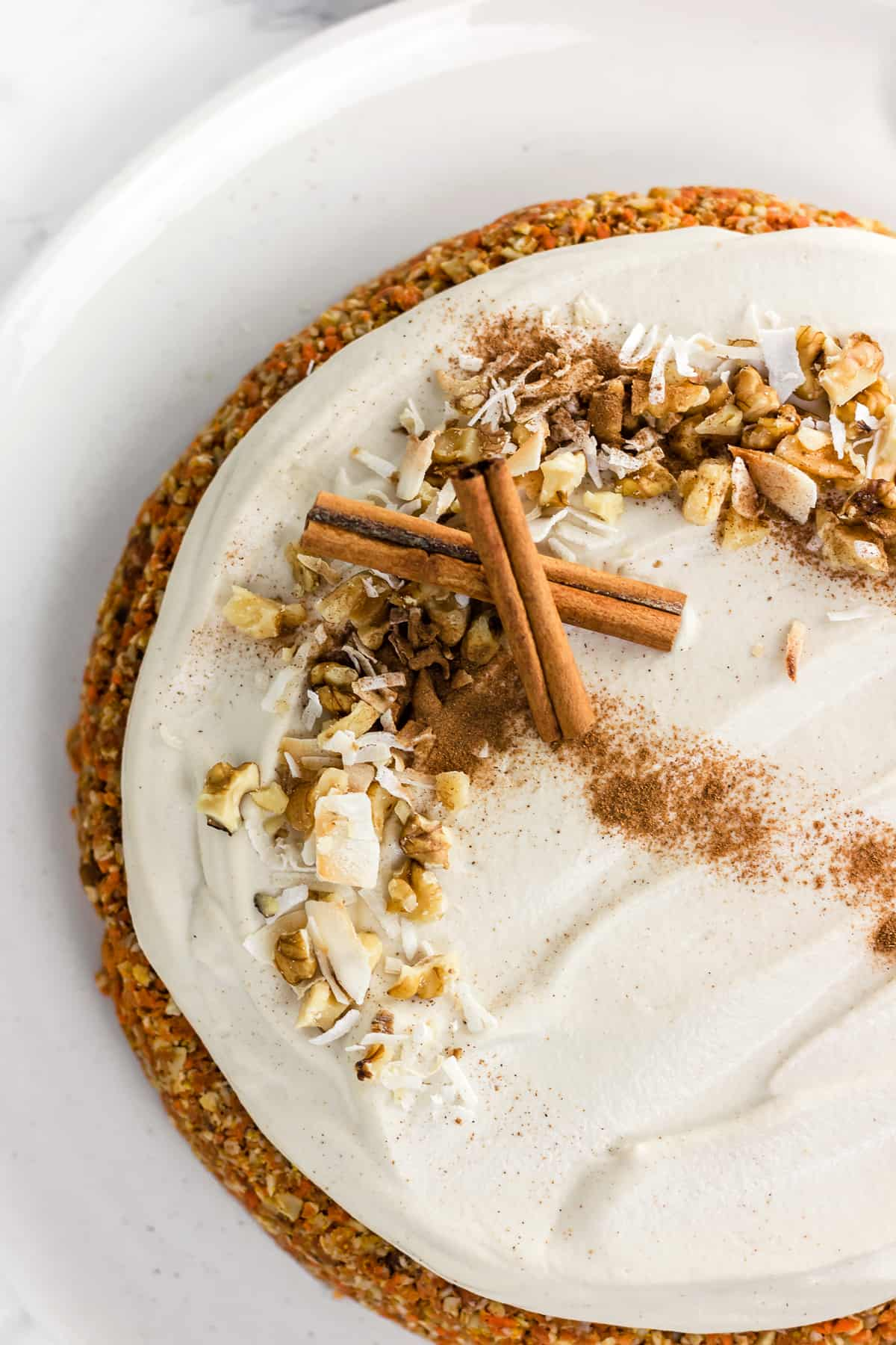 """No baking required for this delicious and healthy Raw Carrot Cake with Cashew """"Cream Cheese"""" Frosting.  It's vegan, gluten free, and refined sugar free!"""