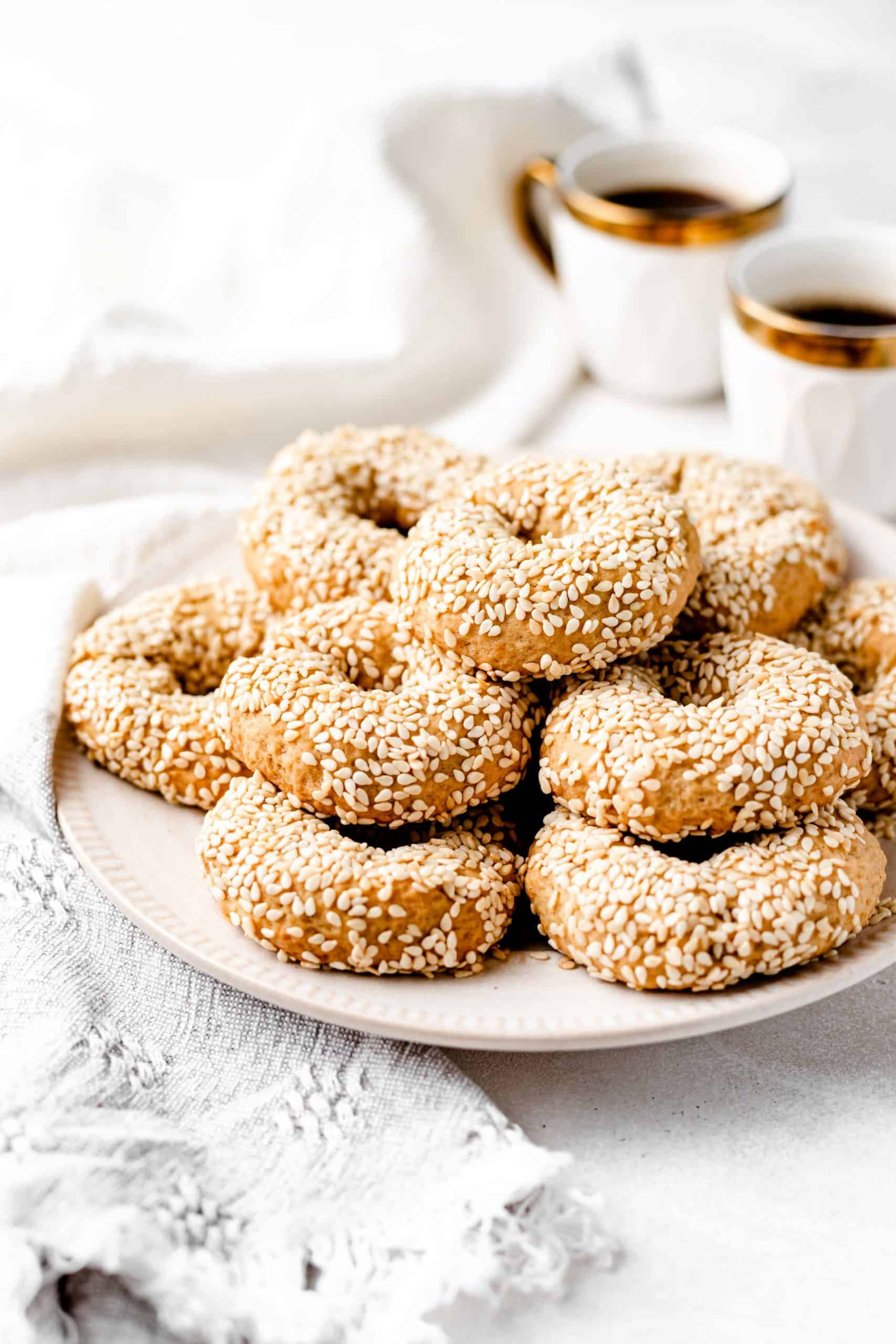 vegan sesame cookies stacked on a plate