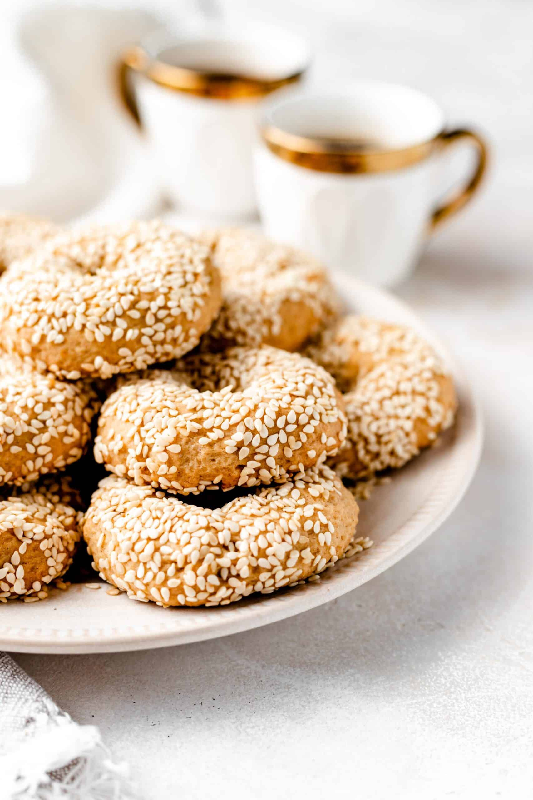 sesame cookies stacked on a plate