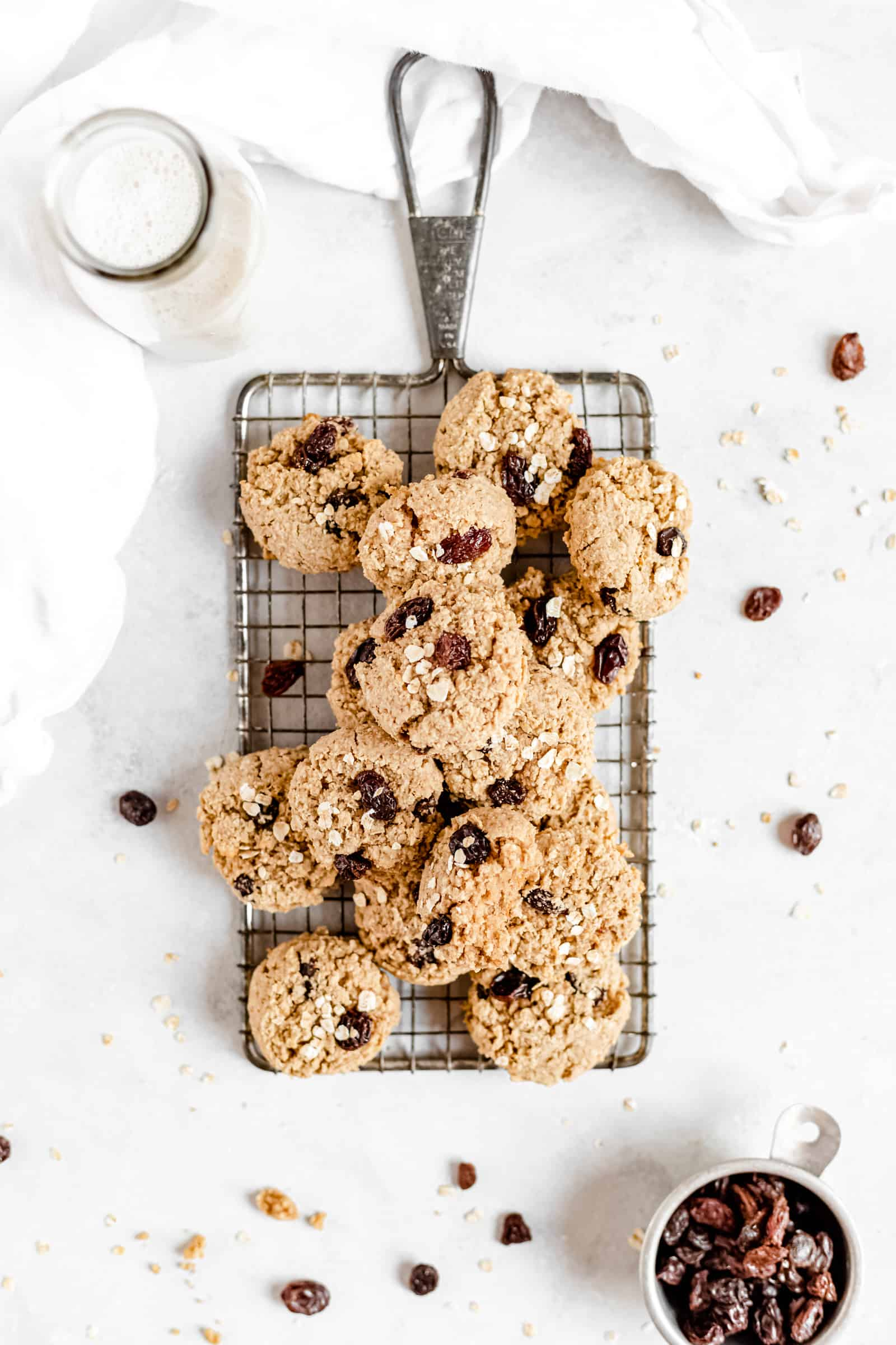 These Healthy Chewy Gluten Free Oatmeal Raisin Cookies are the best ever! They're incredibly soft, chewy, and perfectly spiced with a hint of cinnamon. #vegan #glutenfree #oatmealraisin #cookies #healthycookies #almondflour #bakedambrosia