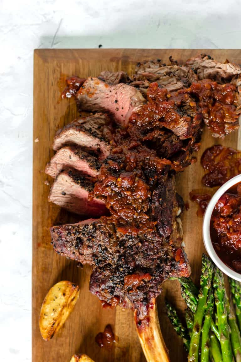 Grilled Black Peppercorn Tomahawk Ribeye with Spicy Barbecue Relish