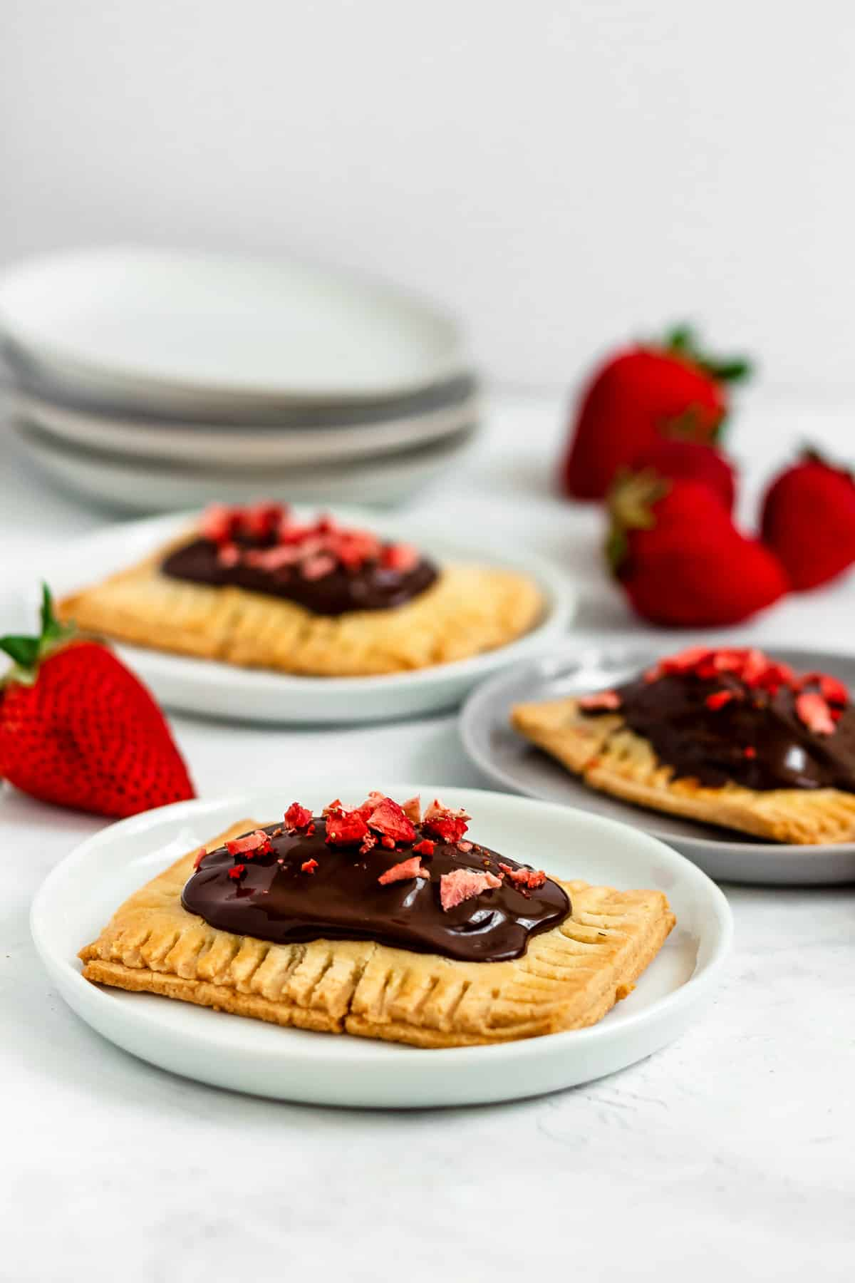 Healthy, gluten free Paleo Chocolate Covered Strawberry Pop Tarts made with a fresh strawberry filling. This healthy make-ahead breakfast, snack or dessert is easy to make, and perfect for using up your summer strawberries! (gluten free, grain free, refined sugar free)
