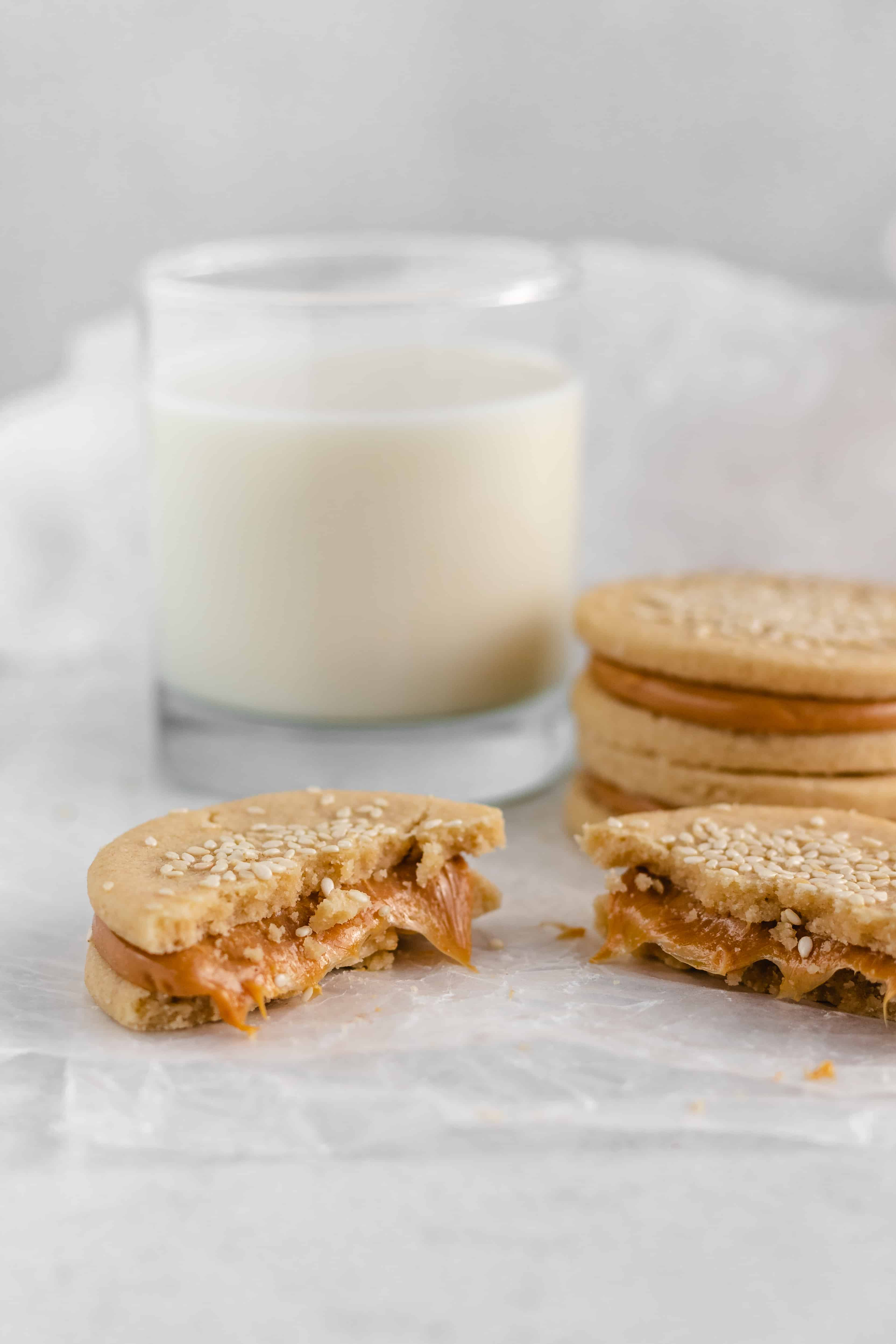 Tahini Shortbread CooButtery and richTahini Cookies are sandwichedtogether with dulce de leche for a decadent treat.kies with Dulce de Leche