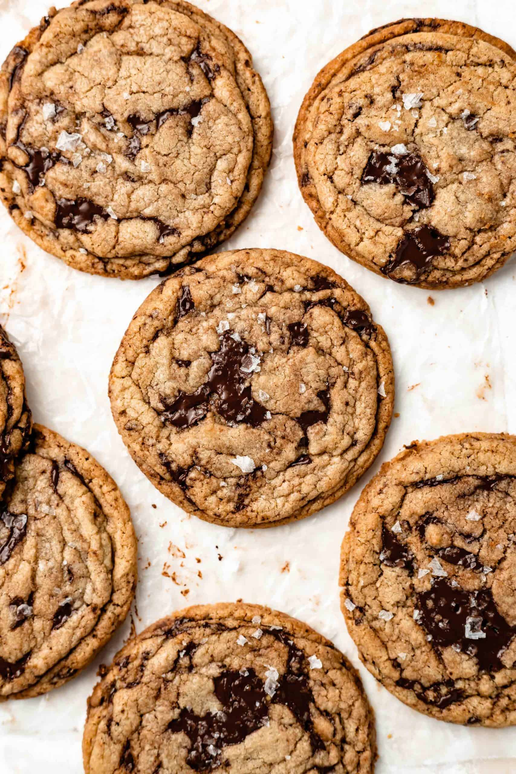 tahini chocolate chip cookies on parchment paper