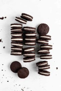An easy and delicious gourmet version of everyone's favorite childhood treat - Homemade Oreo Cookies are crisp chocolate cookies with a cream-filled center.