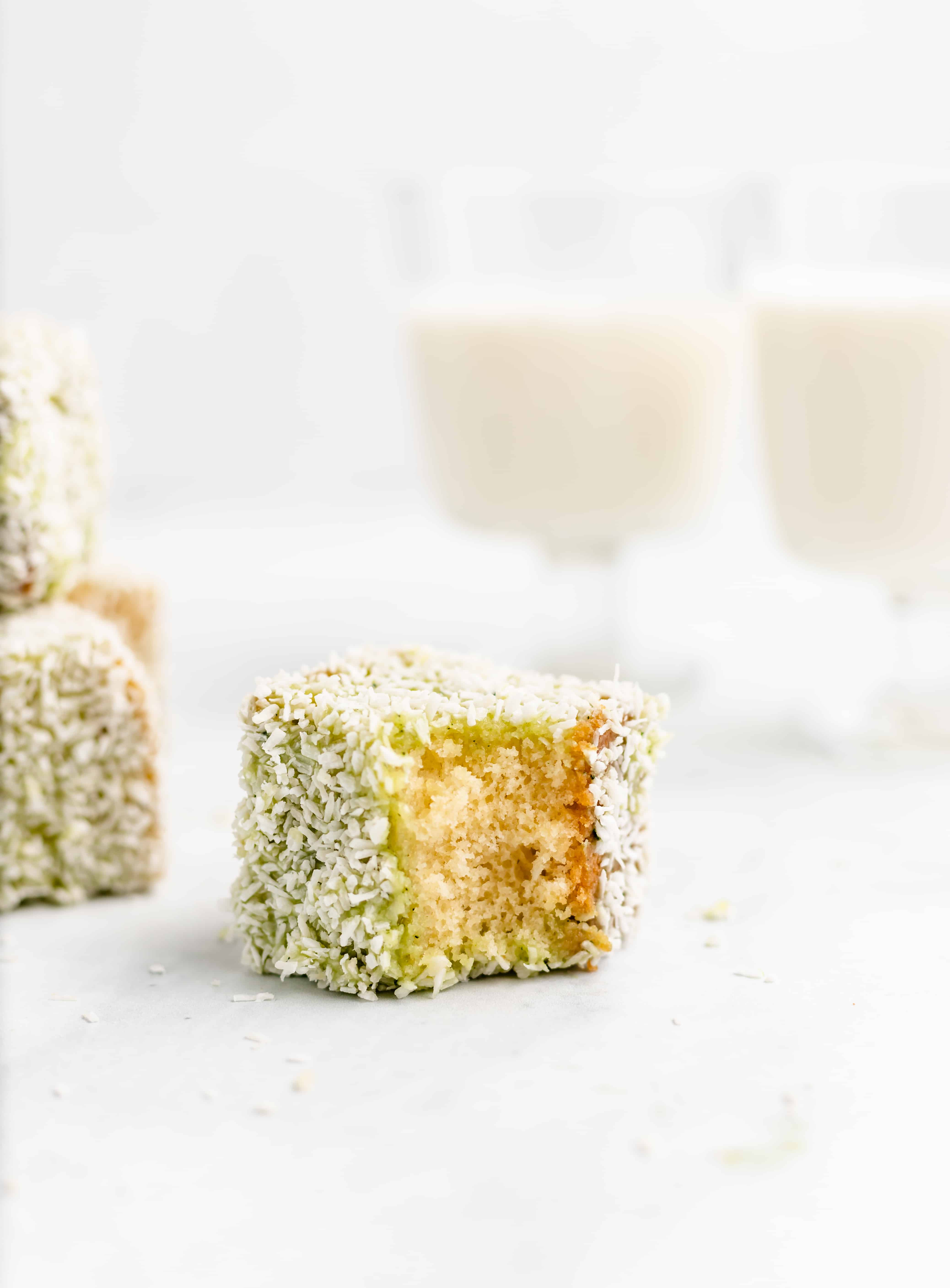 Soft and buttery sponge cake is dipped in matcha flavored white chocolate then coated in coconut. These Matcha White Chocolate Lamingtons are a perfect afternoon treat!