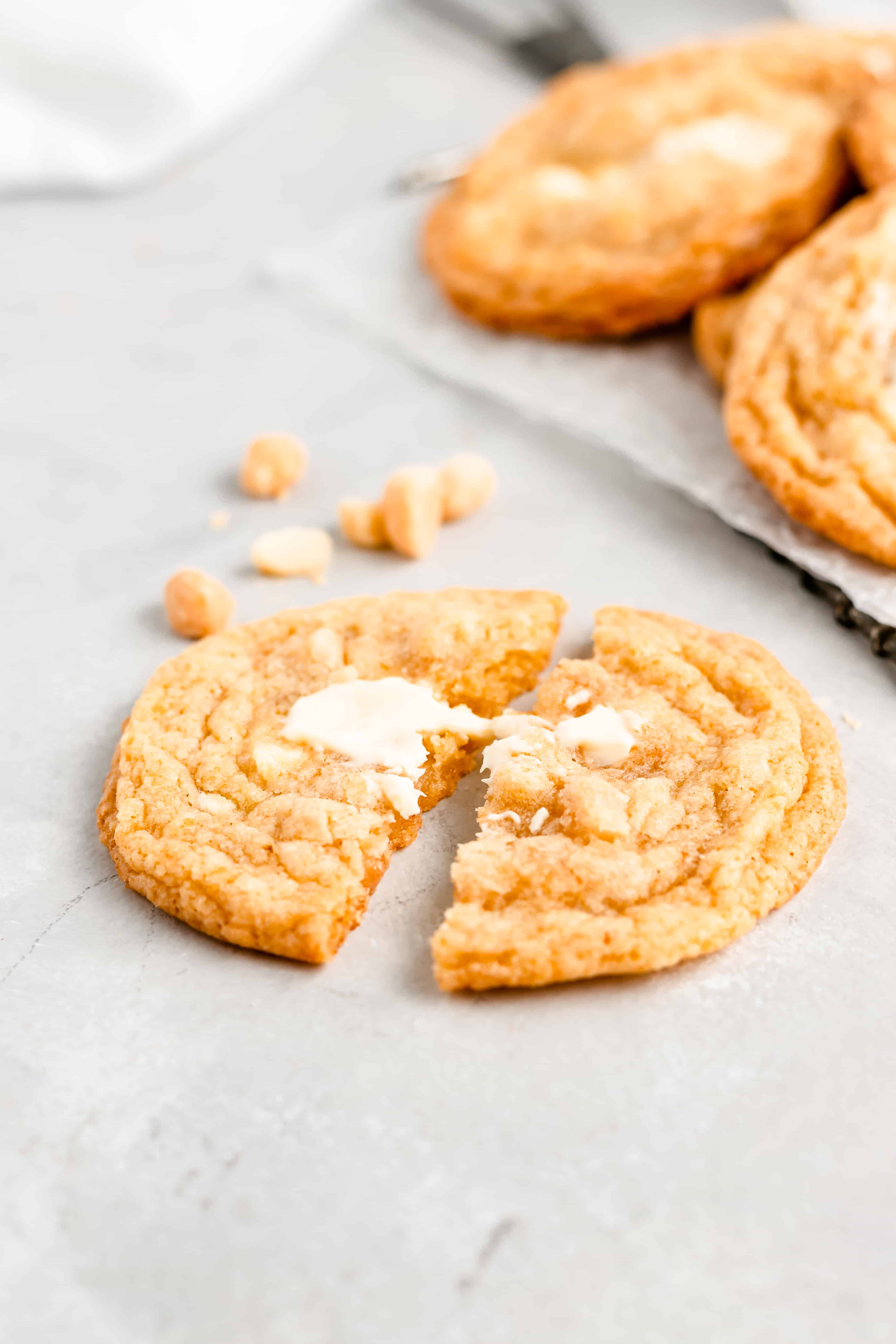 The ONLY White Chocolate Macadamia Nut Cookie recipe you need! Full of white chocolate chunks, roasted macadamia nuts, and fresh orange zest.