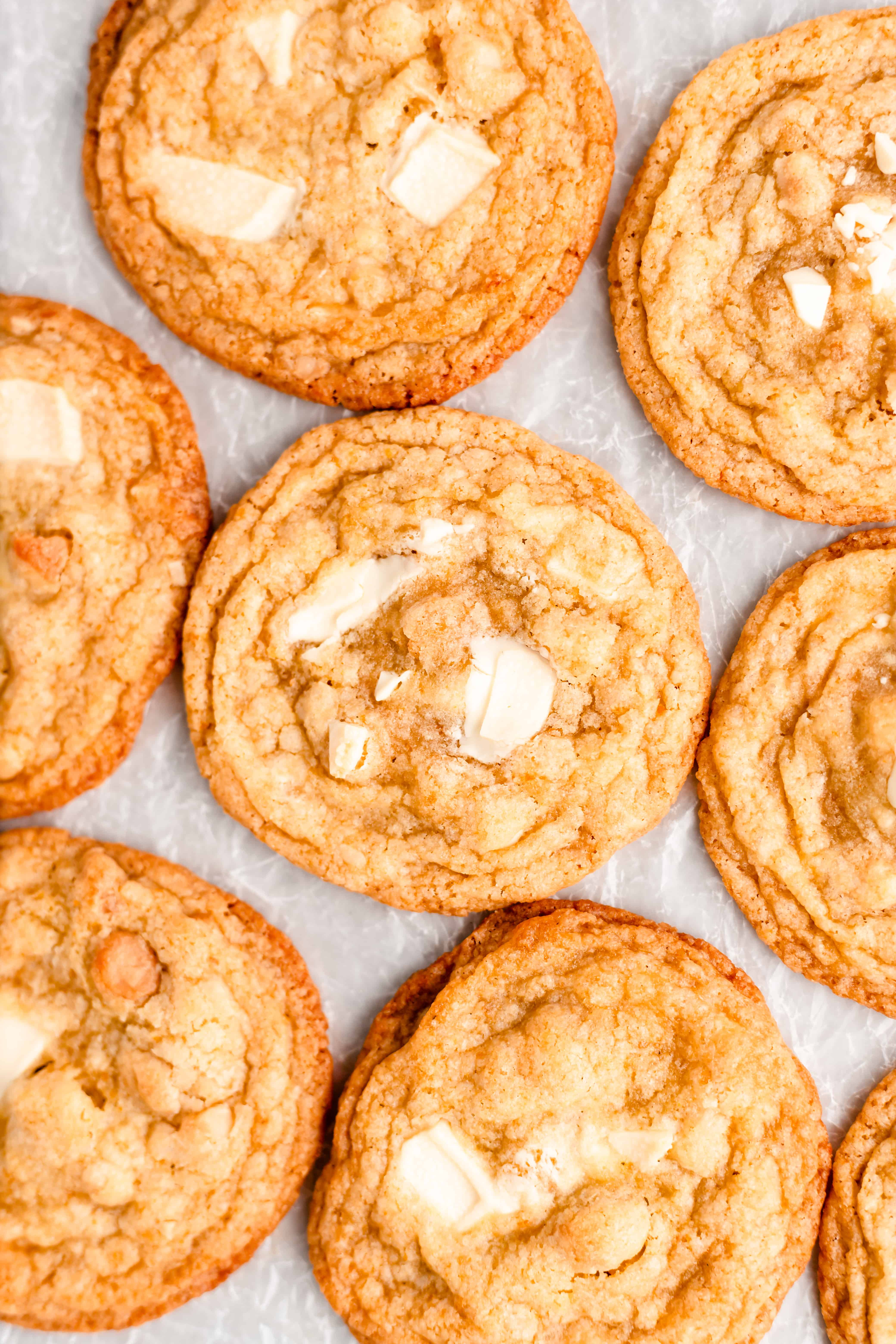 These White Chocolate Orange Macadamia Nut Cookies are crisp on the edges with soft and chewy centers. Loaded with chunks of white chocolate, roasted macadamia nuts, and bursting with fresh orange flavor, these cookies will be a new favorite!