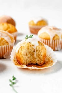 These Lemon Thyme Muffins are fluffy, buttery, and bursting with fresh flavors. Spring flavors are layered in this recipe with the addition of lemon zest and fresh thyme to the batter and a tart lemon-juice glaze.