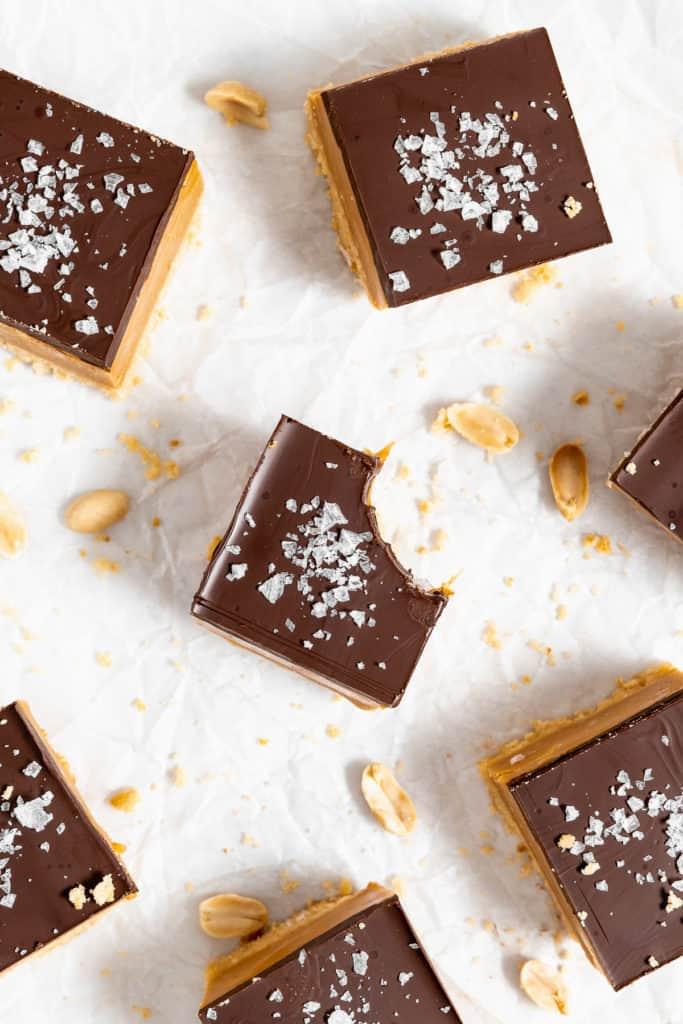 Peanut Butter Millionaire Bars on parchment paper