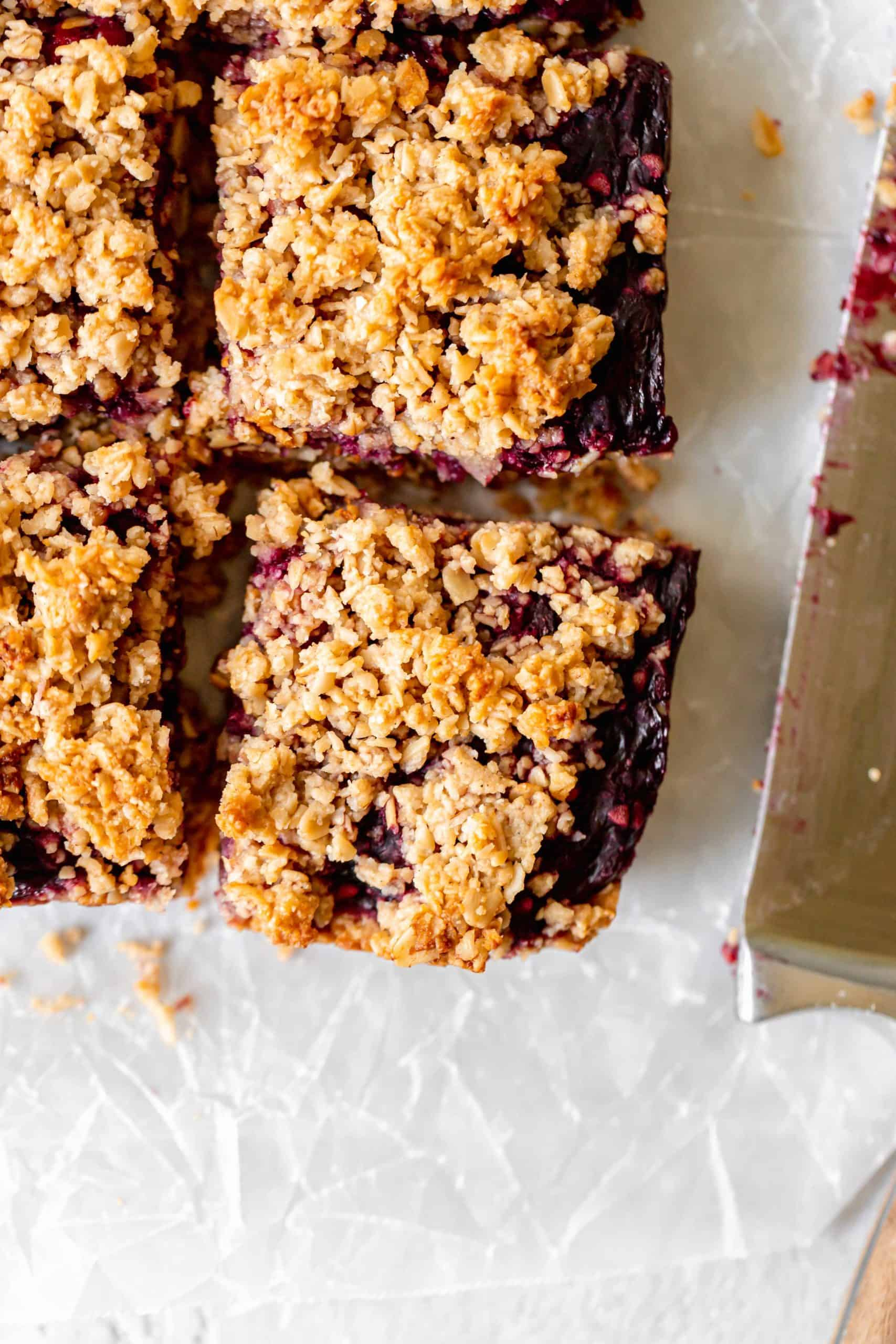 Healthy blackberry crumble bar on parchment paper