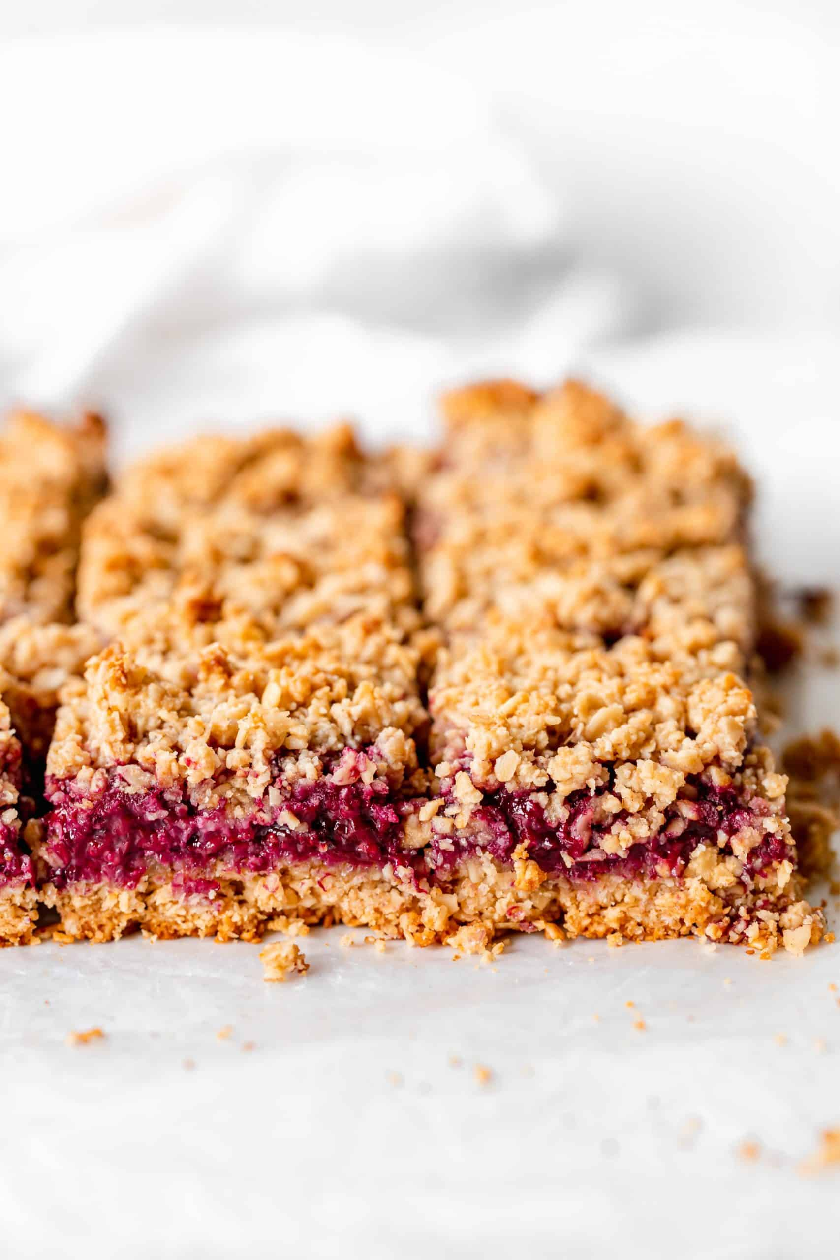 Vegan blackberry crumb bars on parchment paper