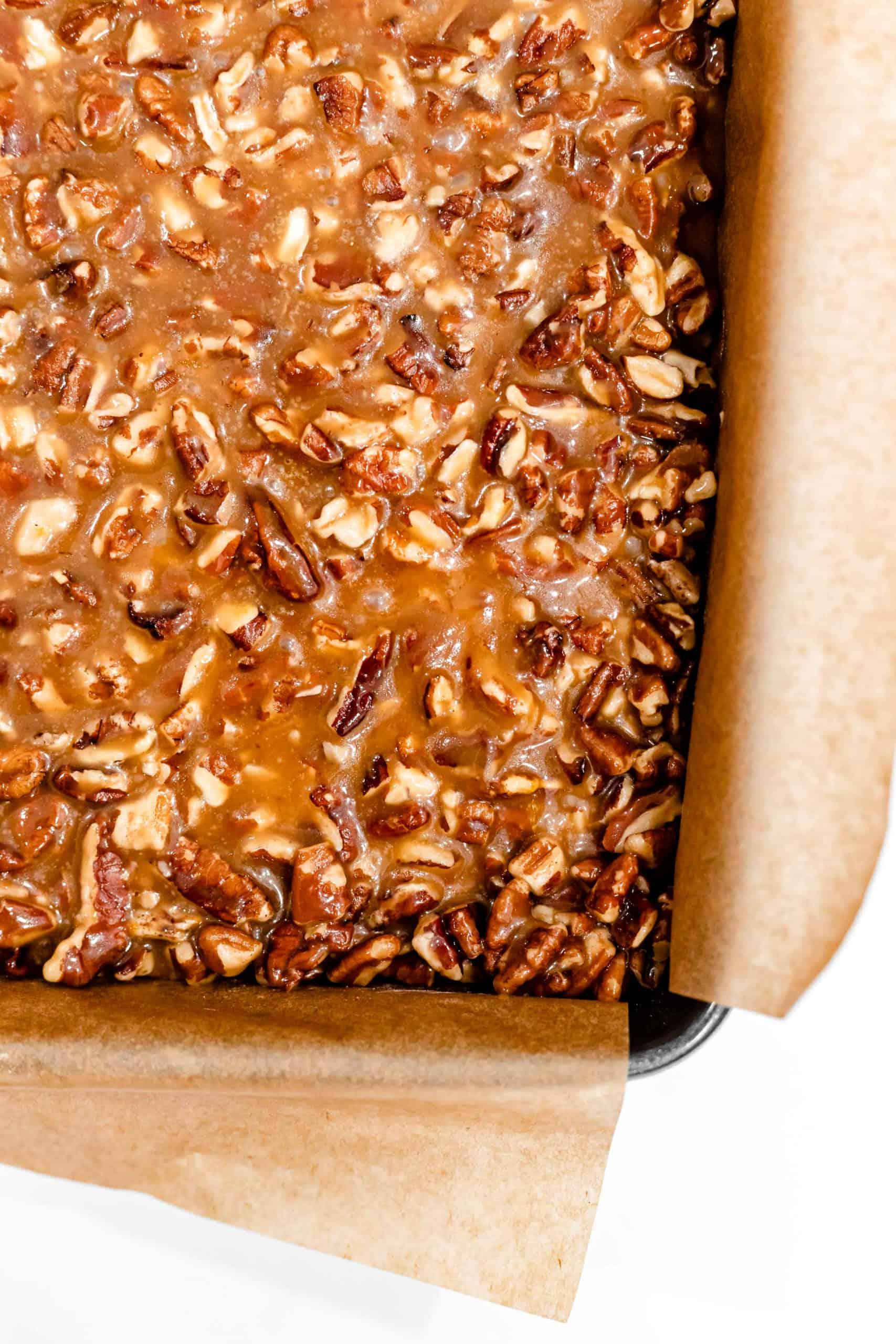 unbaked caramel pecan bars in pan