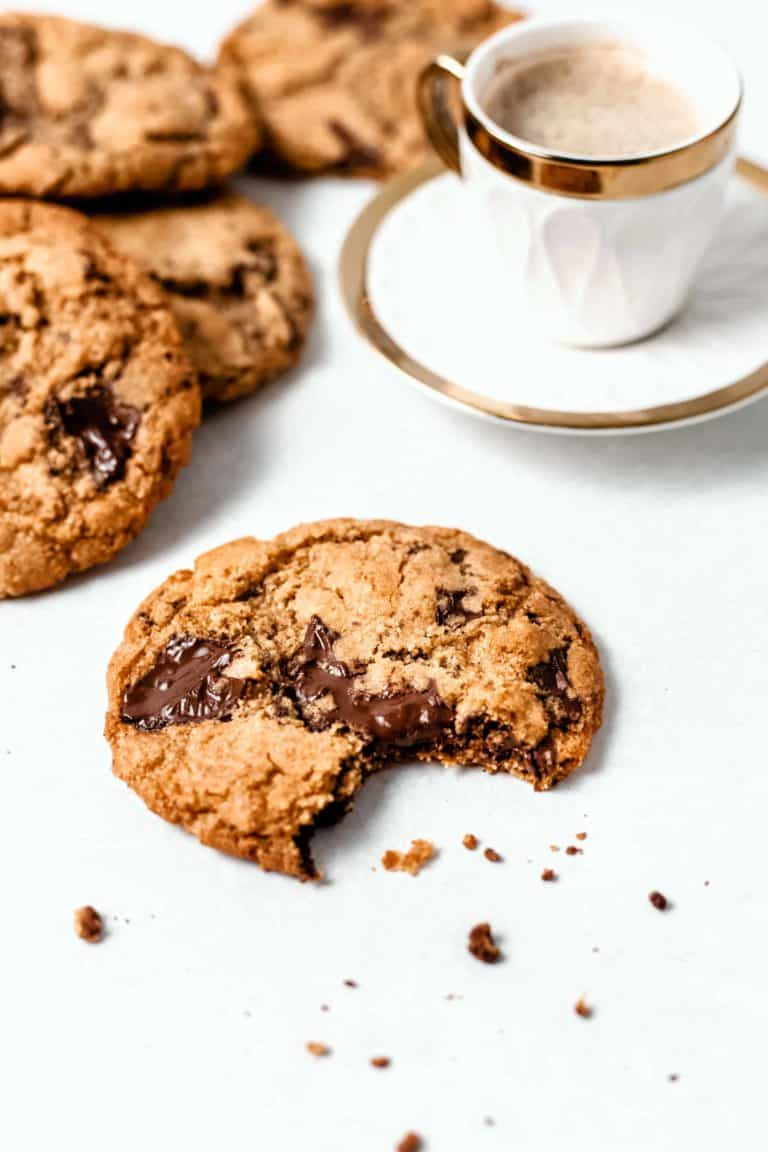 chocolate chip cookie with cup of espresso