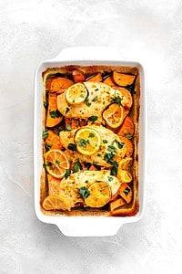 lemon chicken with sweet potatoes in roasting pan