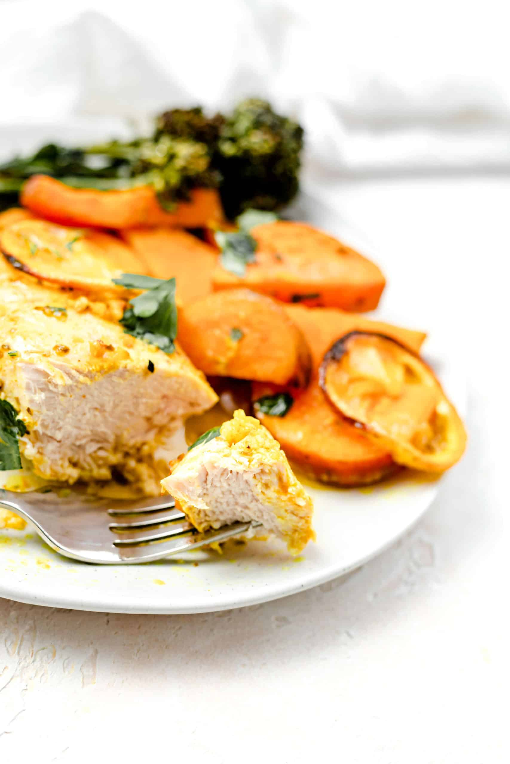 chicken and sweet potatoes on a plate