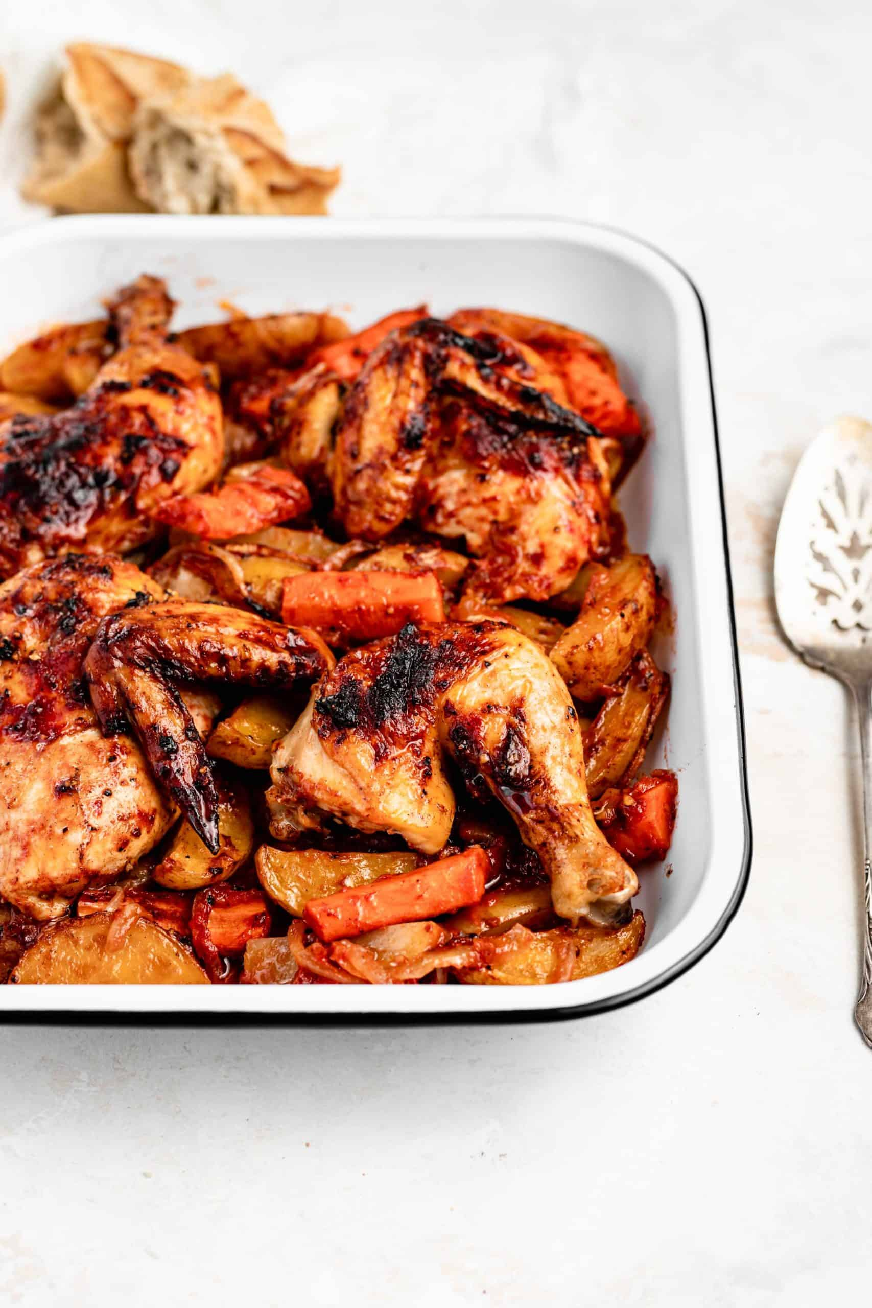 roasted chicken and potatoes in pan