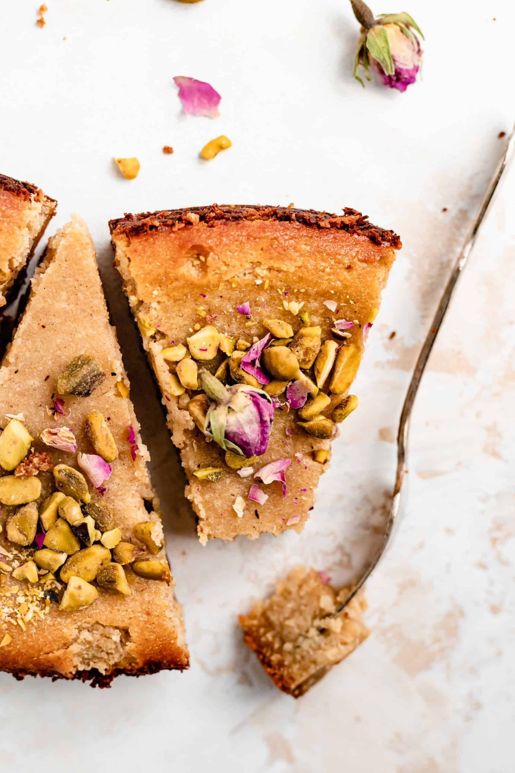 slice of persian love cake with pistachios and rose