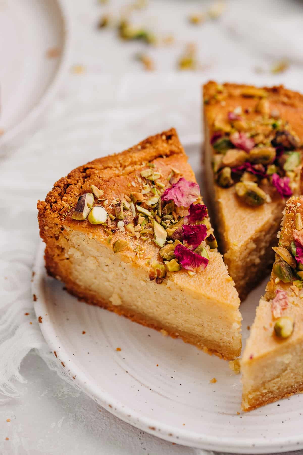 three slices of persian love cake on a white plate.