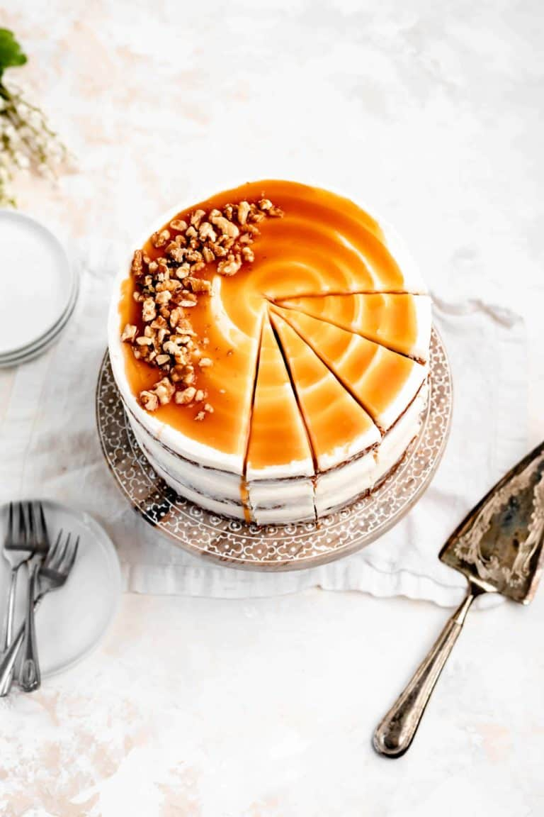 frosted carrot layer cake with caramel and walnuts