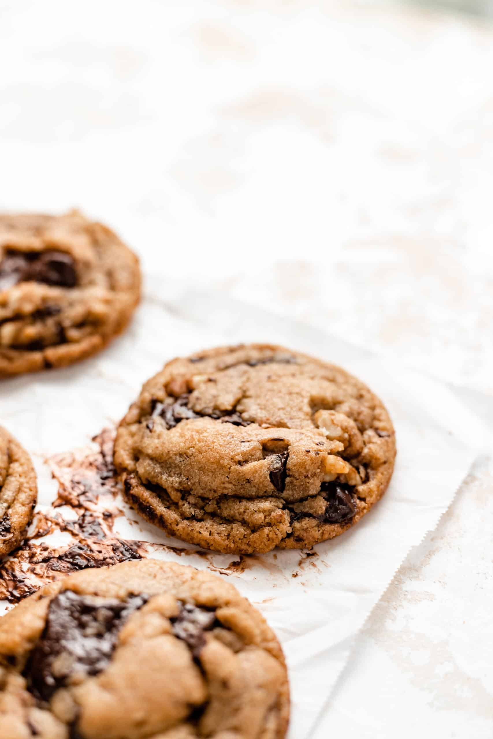 vegan chocolate chip cookies on parchment
