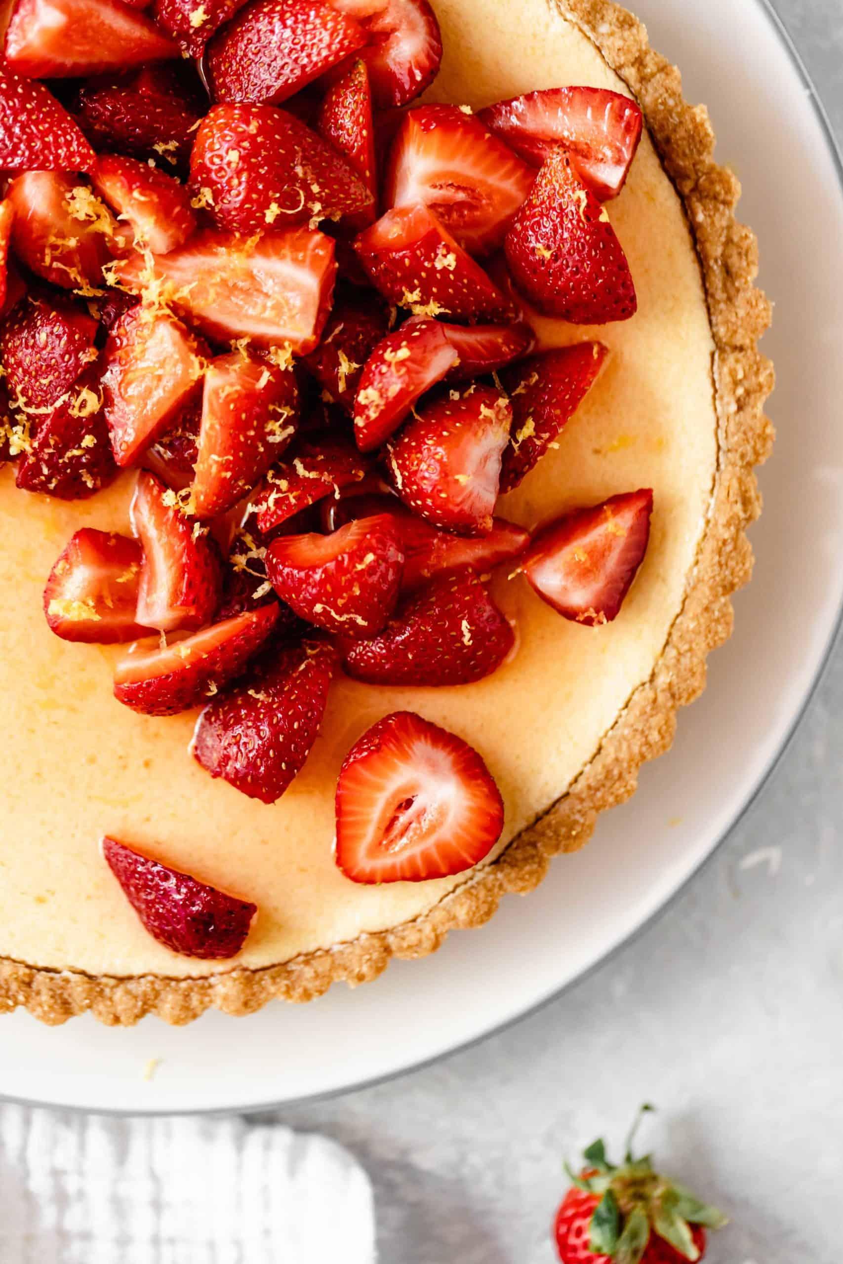 sliced strawberries on a lemon tart