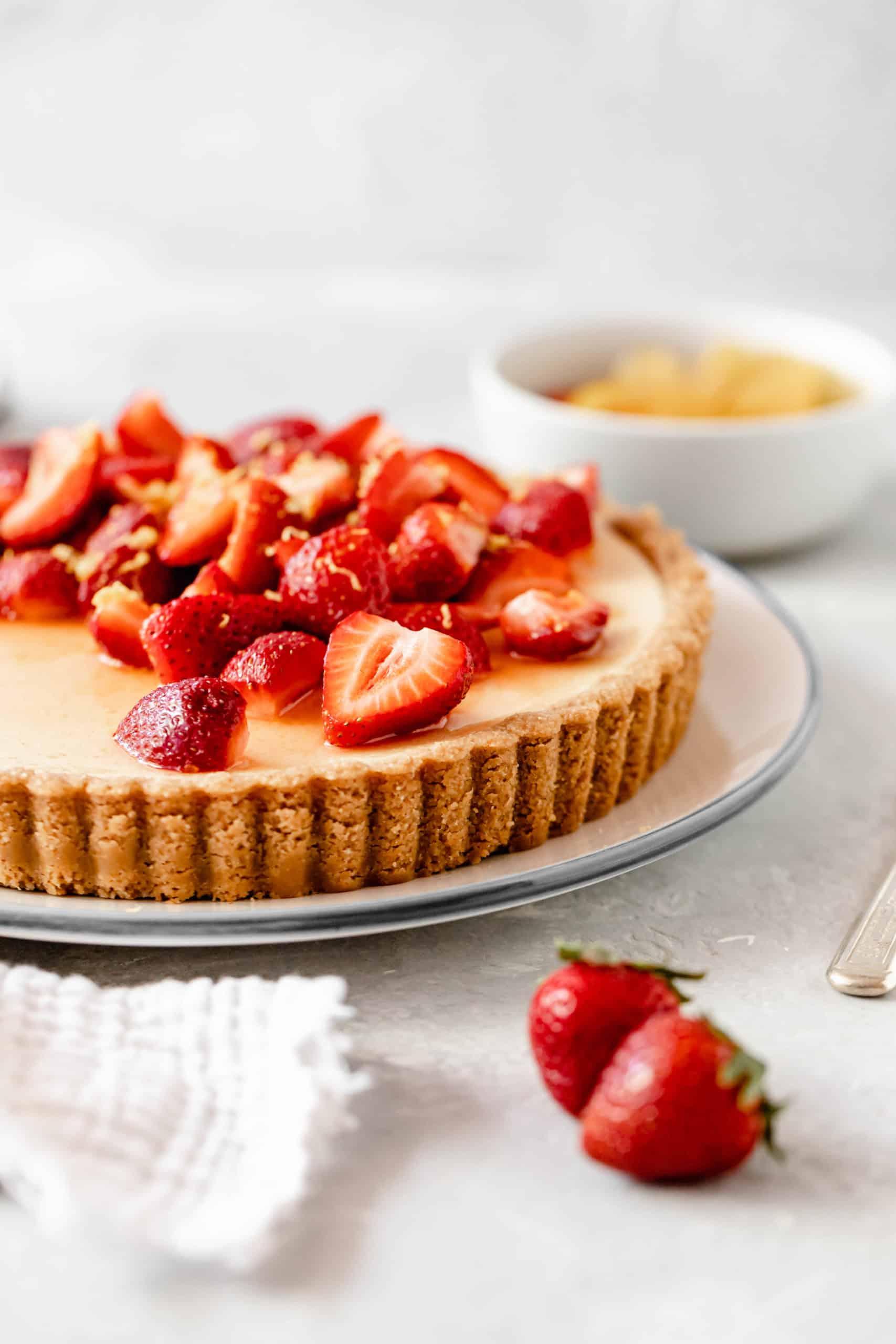 Lemon tart with sliced strawberries