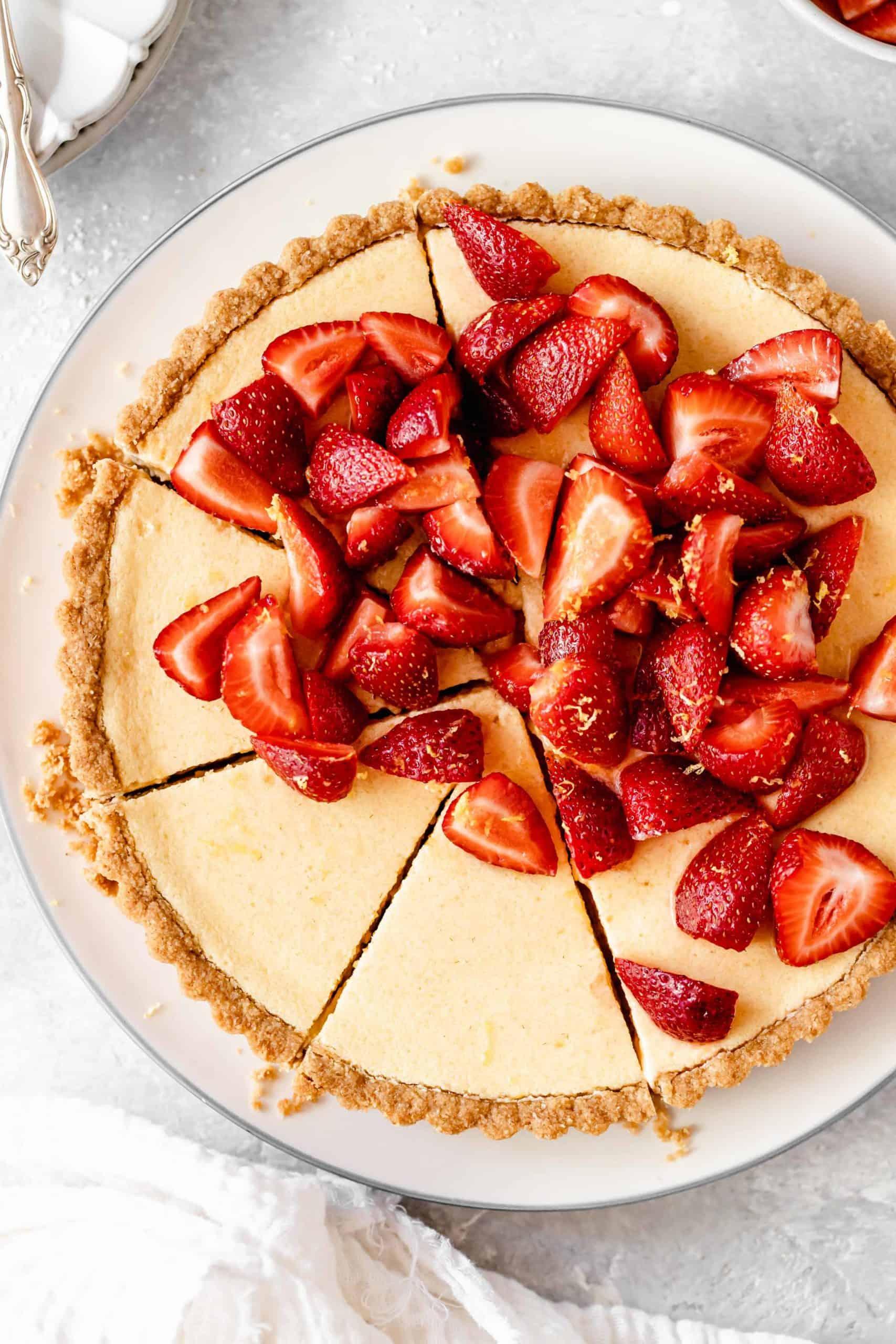 Sliced lemon tart with strawberries