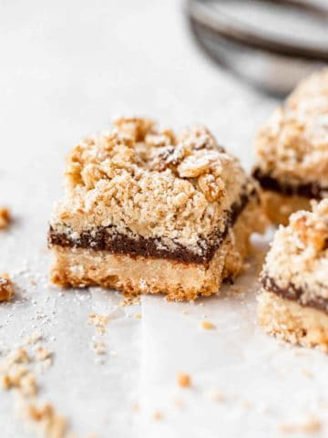chocolate crumb bars on parchment paper