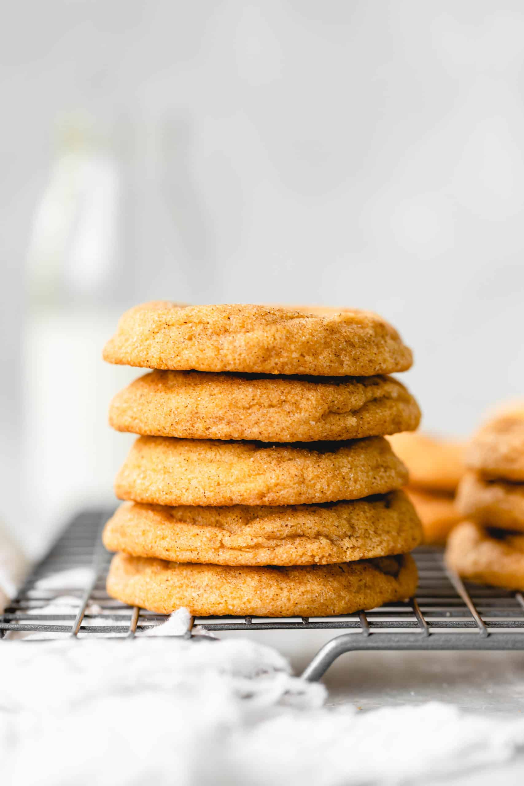 stack of pumpkin snickerdoodles on a wire rack