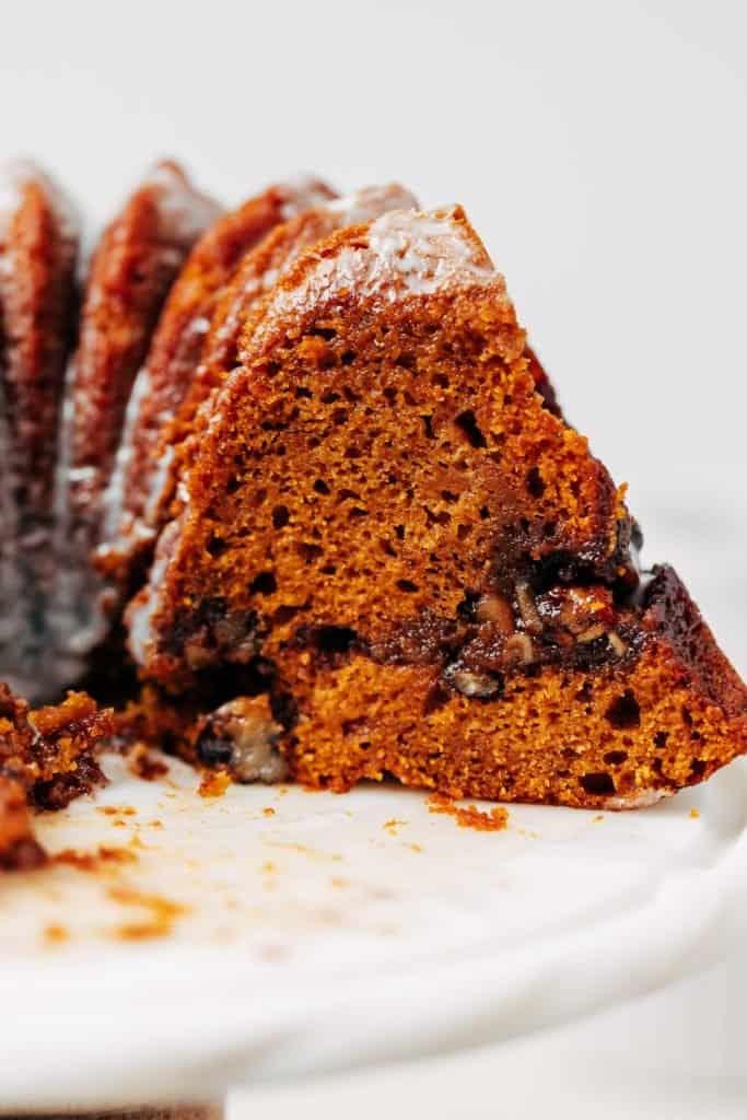 slice of of pumpkin bundt cake with streusel and glaze