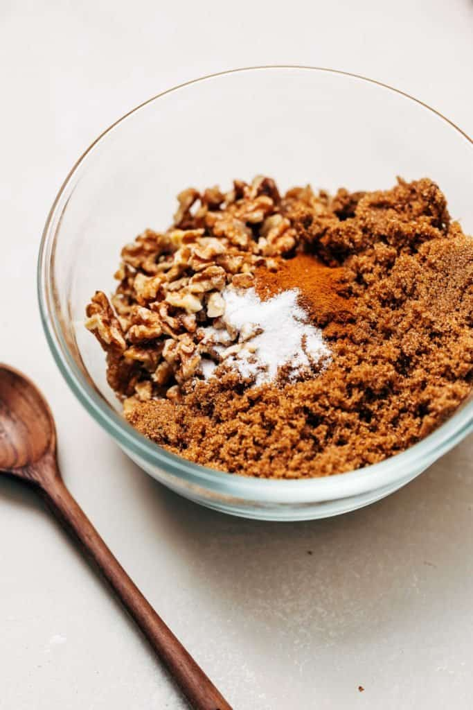 walnuts, brown sugar, and cinnamon in a bowl